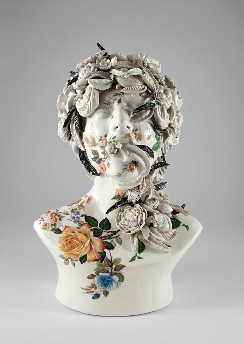 Ceramic Busts Overgrown With Twisted Vines and Colorful