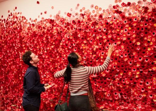 Crowds enjoy Yayoi Kusama's Flower obsession 2017 on display at NGV Triennial 2017. Photo: Sam Wong