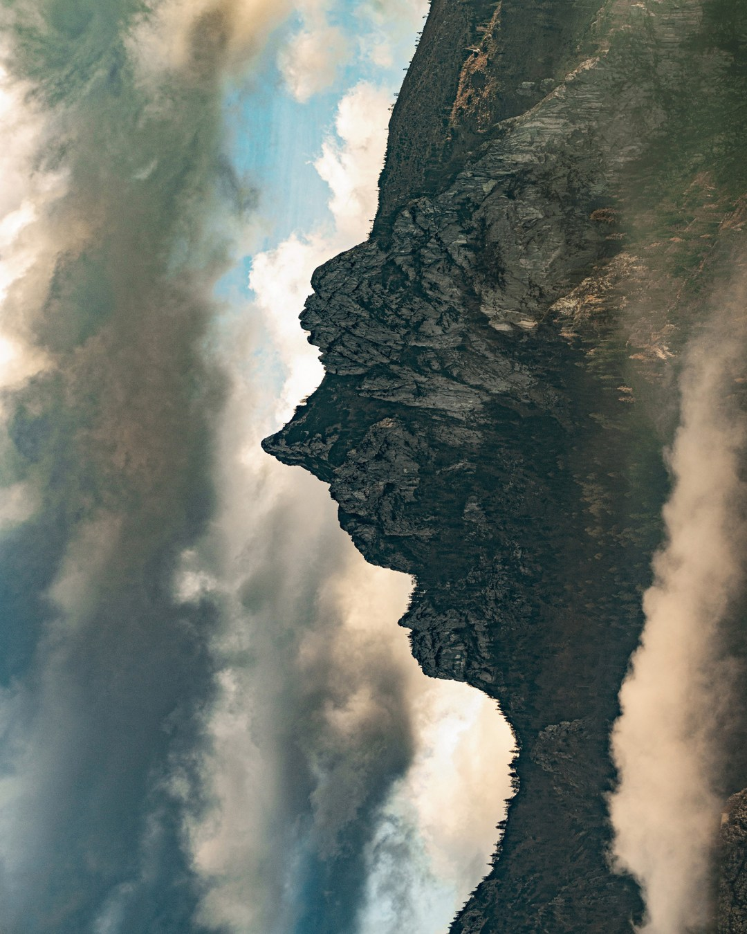 Illusory Photographs of Mountain Landscapes Are Flipped 90 Degrees to Reveal Human-Like Profiles