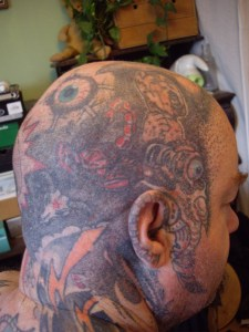 Simon Marshall-Jones head tattoos