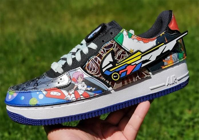 Air Force Nike And The Mighty Swooshers in front of grass