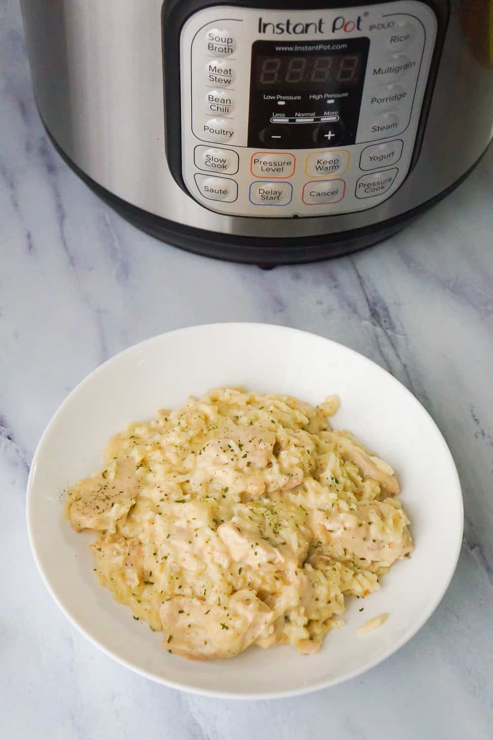 Instant Pot Garlic Parmesan Chicken and Rice is an easy chicken dinner recipe perfect for busy weeknights. This chicken dish is rich and creamy and loaded with Parmesan cheese.