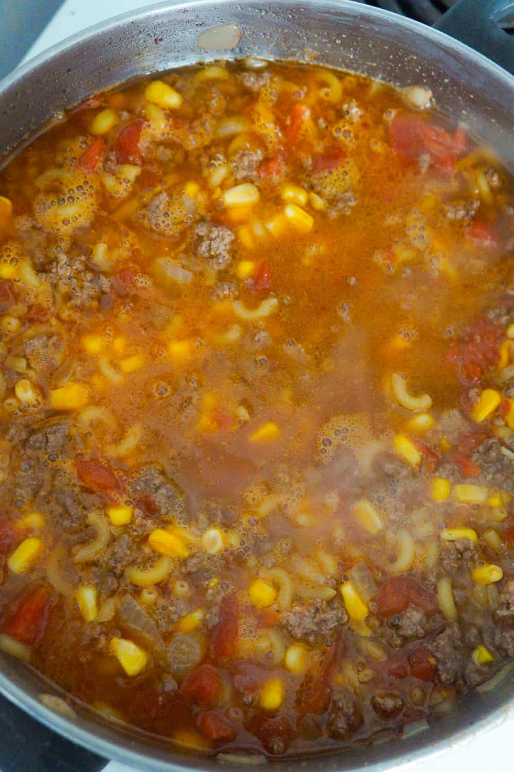 beef goulash simmering in a large pot