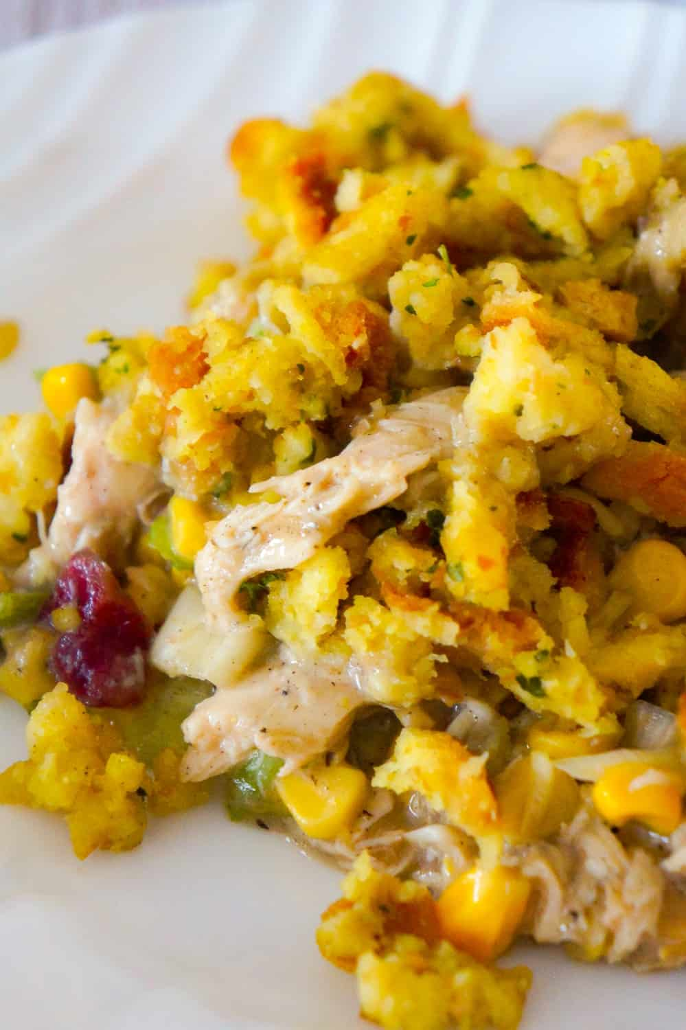 Chicken Casserole with Stuffing is an easy chicken dinner recipe perfect for weeknights. This hearty chicken casserole is loaded with shredded rotisserie chicken, corn, green onions and cranberry sauce and topped with stove top stuffing.