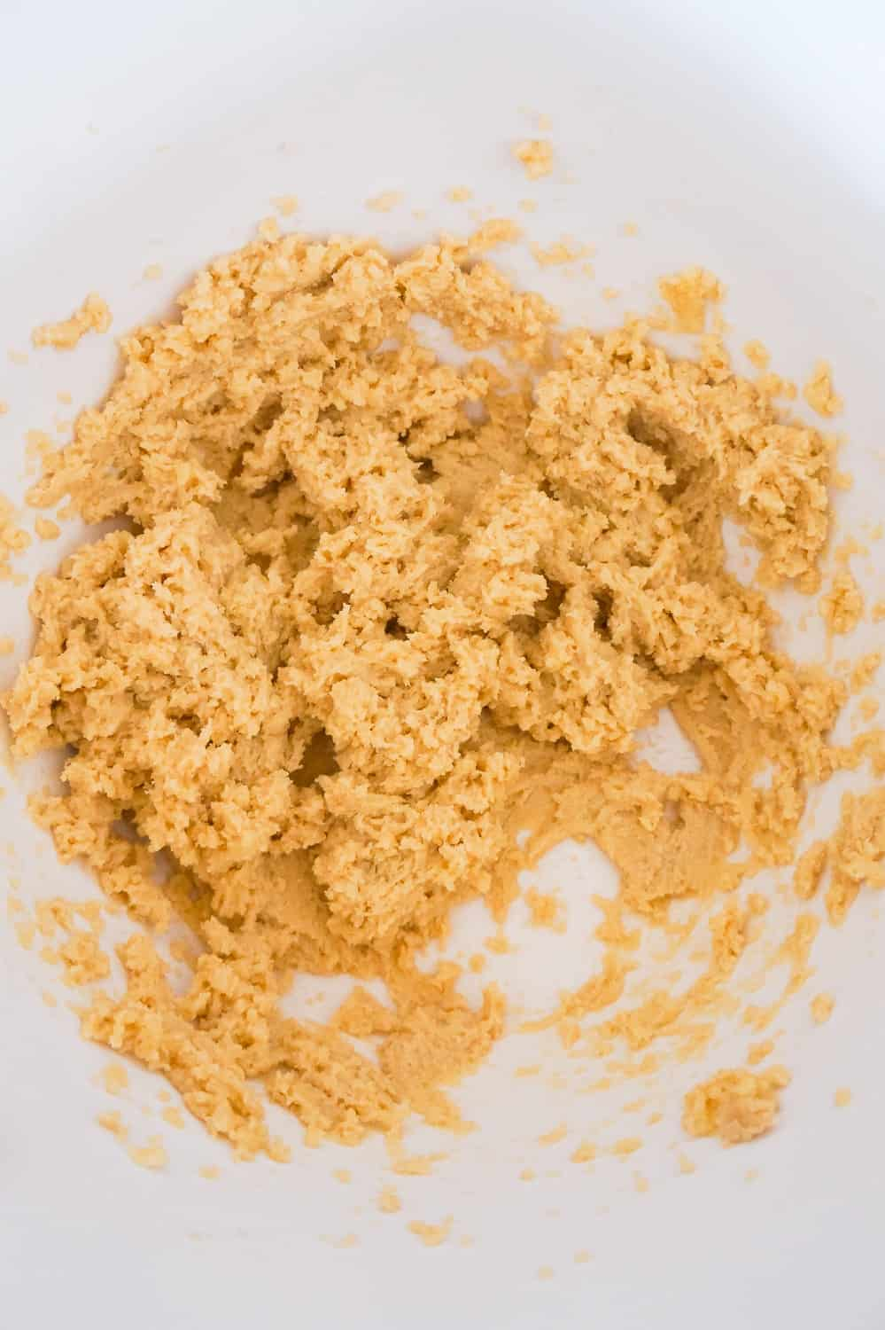 Crisco, brown sugar and granulated sugar creamed together in a mixing bowl