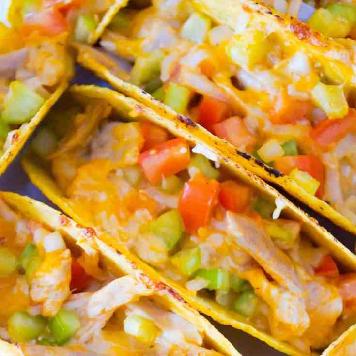 Buffalo Chicken Tacos are an easy dinner recipe using rotisserie chicken. These baked chicken tacos are loaded with buffalo sauce, ranch dressing, celery, tomatoes, onions and cheddar cheese.