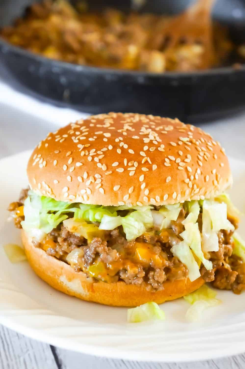 Big Mac Sloppy Joes are an easy ground beef dinner recipe perfect for weeknights. These sloppy joes are loaded with onions, pickles and cheddar cheese all tossed in a copycat Big Mac Sauce.