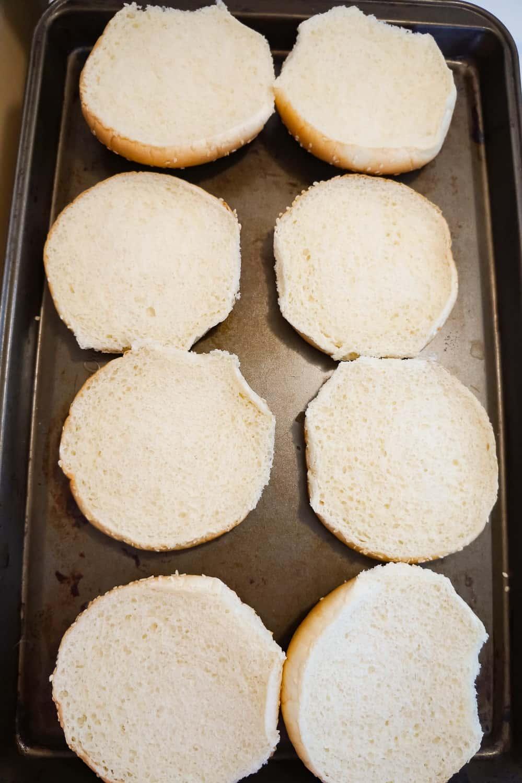 hamburger buns on a baking sheet