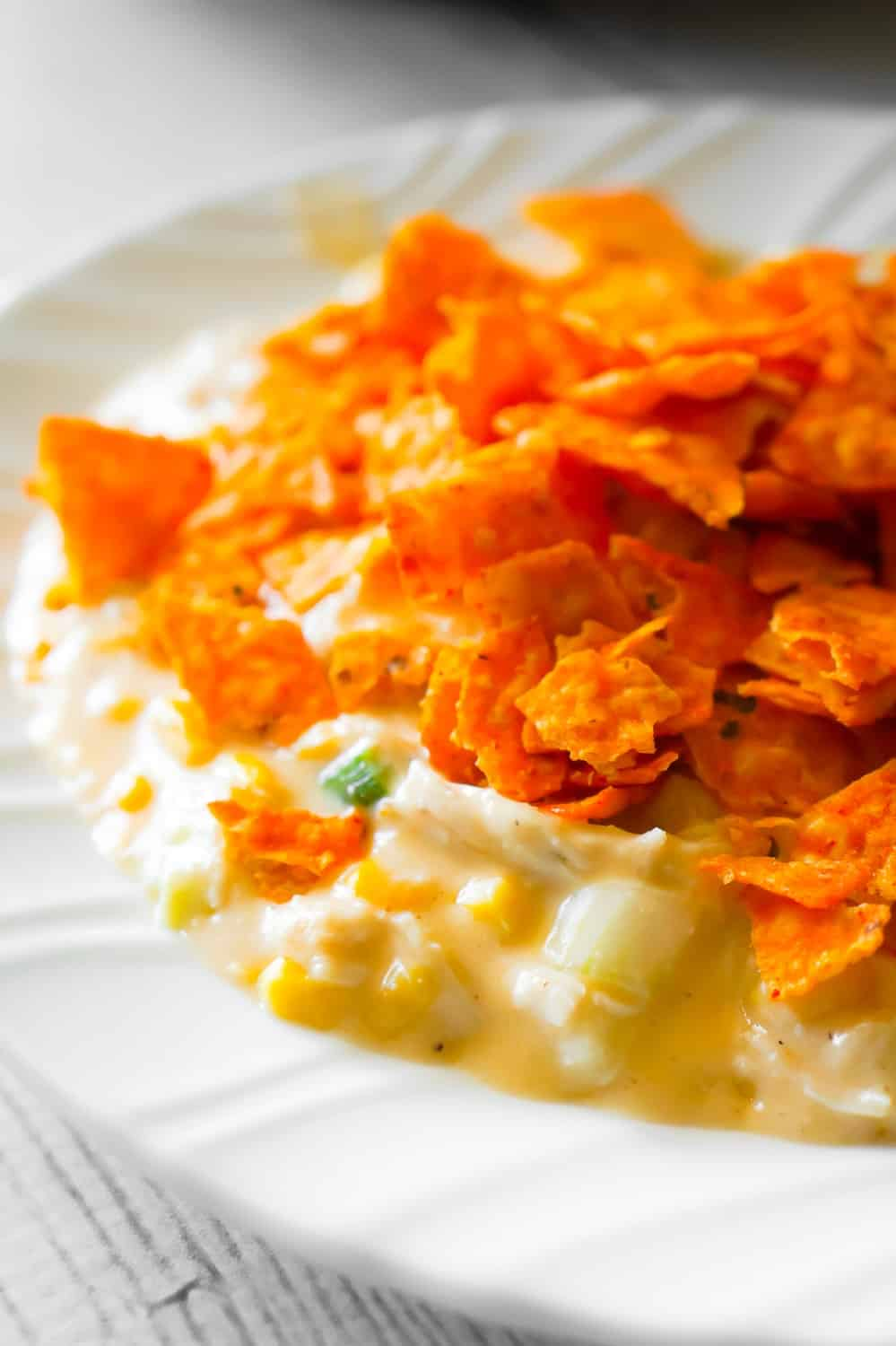 Instant Pot Doritos Chicken Casserole is an easy chicken dinner recipe the whole family will love. This creamy chicken casserole is loaded with corn, green onions, cream cheese, mozzarella and cheddar cheese.