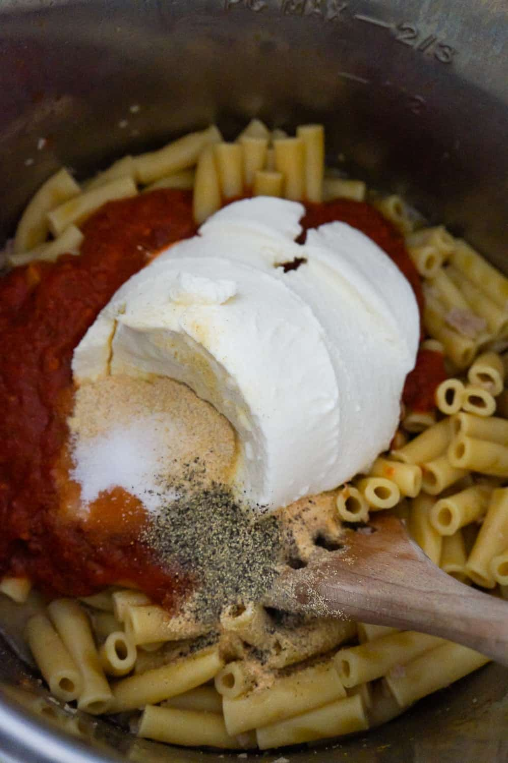 ricotta and marinara on top of cooked ziti in an Instant Pot