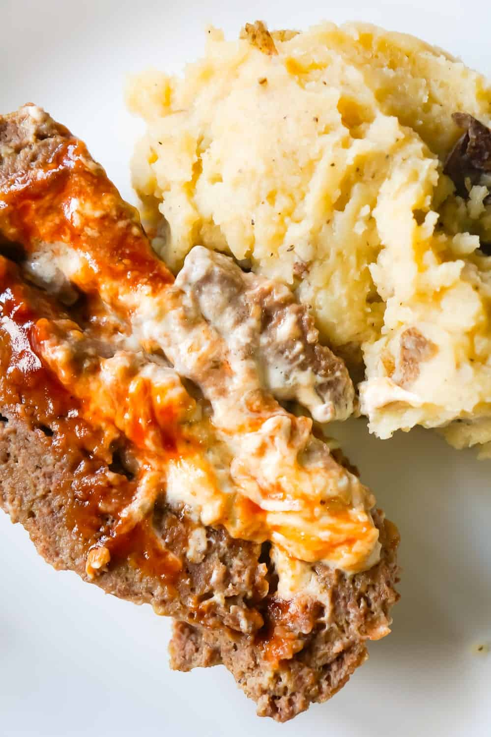 Instant Pot Cream Cheese Stuffed Meatloaf and Mashed Potatoes is an easy dinner recipe all cooked together in the Instant Pot. This delicious meatloaf is stuffed with Philadelphia Chive Whipped Cream Cheese and Sweet Baby Ray's BBQ Sauce.