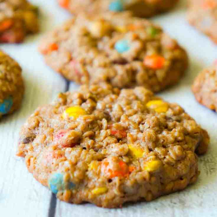Chocolate Monster Cookies are an easy peanut butter dessert recipe using quick oats and mini M&M's. These chewy peanut butter cookies with cocoa powder are a delicious twist on the classic Monster Cookie.