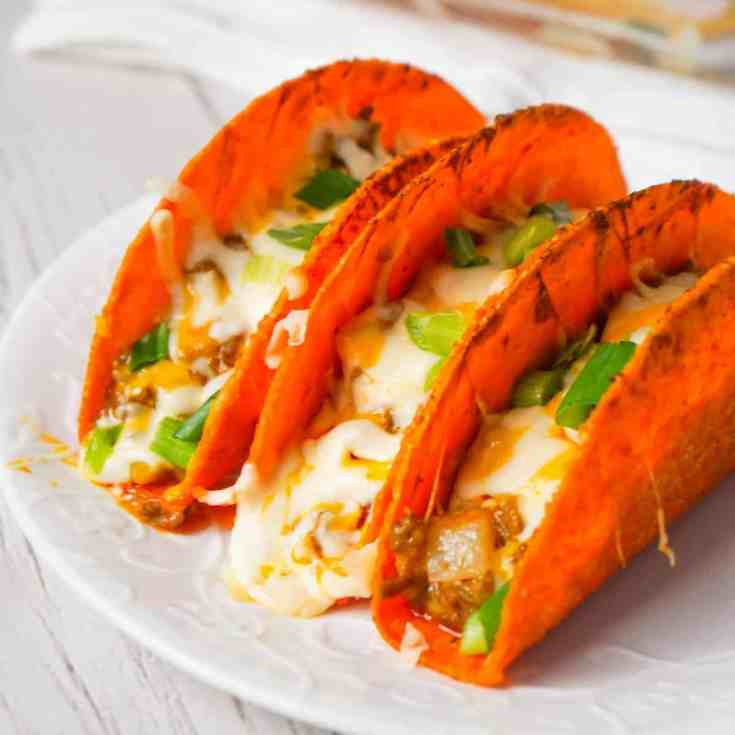 Extra Cheesy Baked Beef Tacos are an easy weeknight dinner recipe using ground beef, salsa con queso cheese dip, shredded mozzarella and cheddar and nacho cheese flavoured stand and stuff taco shells.