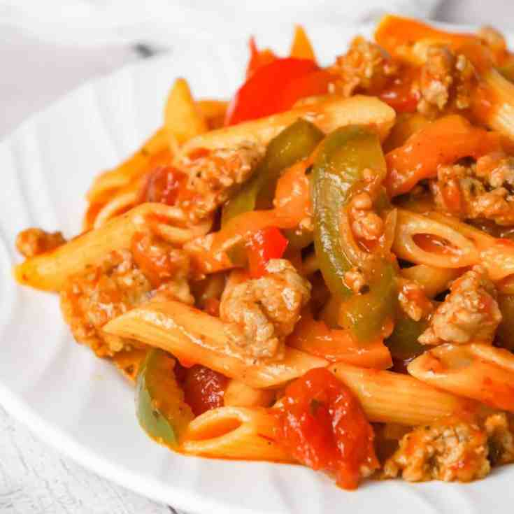 Sausage and Peppers Pasta is a delicious dinner recipe using penne pasta and loaded with sliced bell peppers, onions and Italian sausage meat.