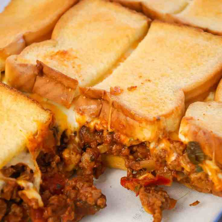 Beef Taco Grilled Cheese Casserole is an easy casserole recipe with layers of toasted bread, cheese and ground beef tossed in salsa, chili sauce and taco seasoning.