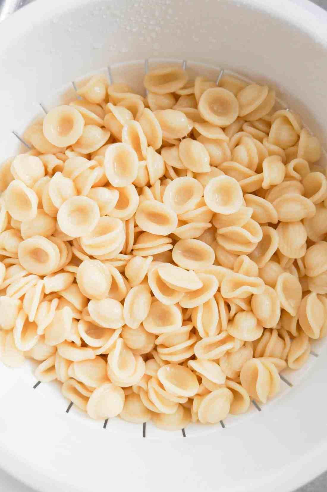cooked orecchiette noodles in a strainer