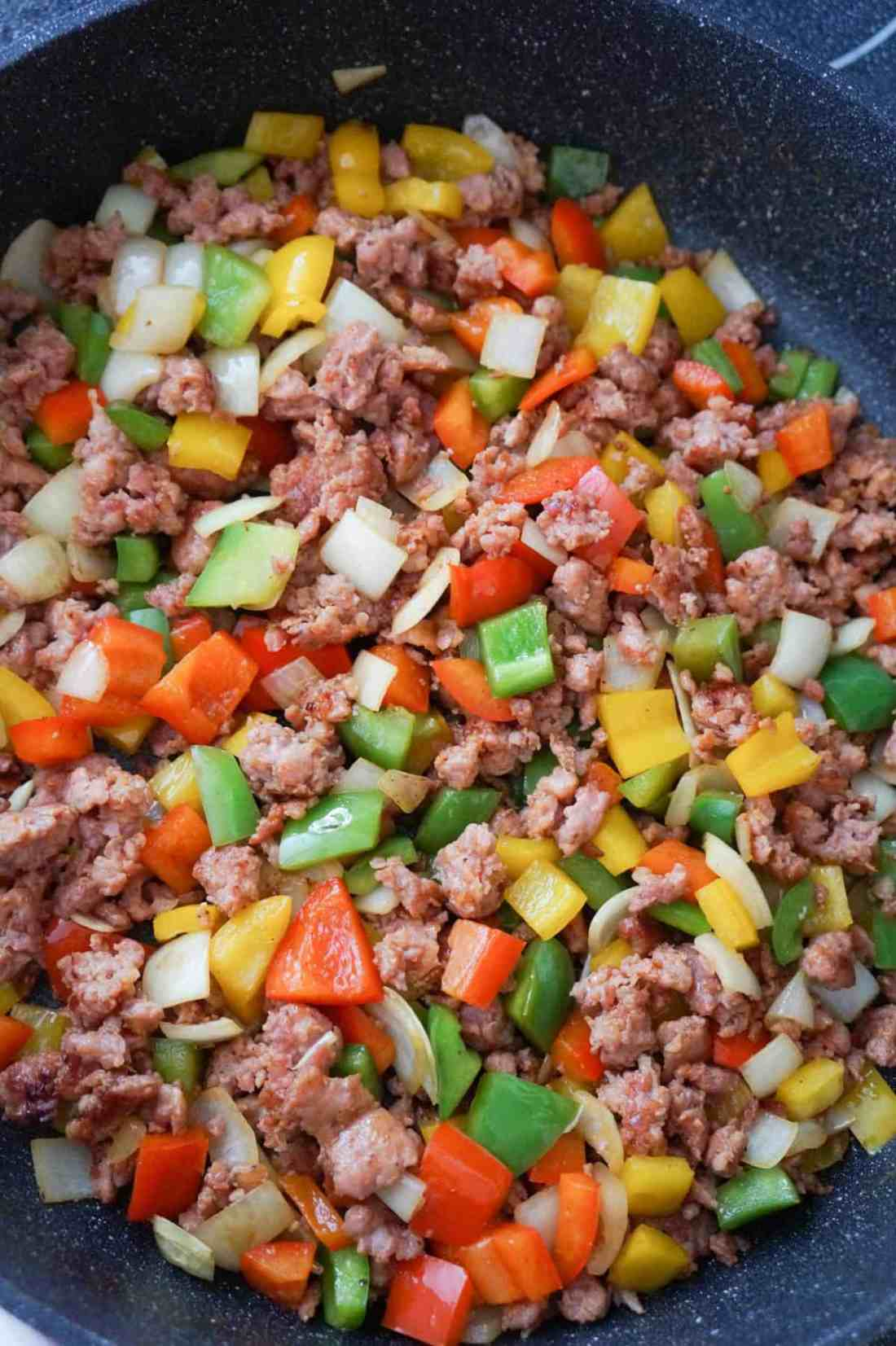 sausage and peppers mixture in a saute pan