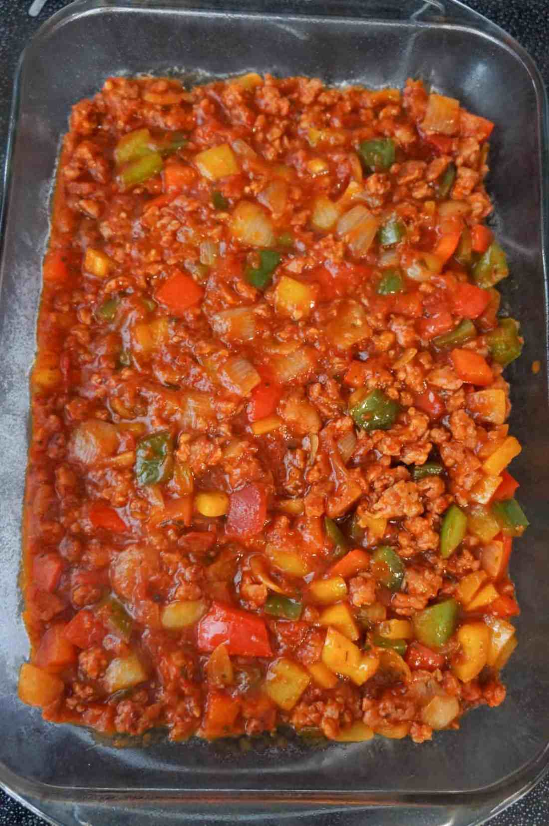 sausage and peppers mixture in a baking dish
