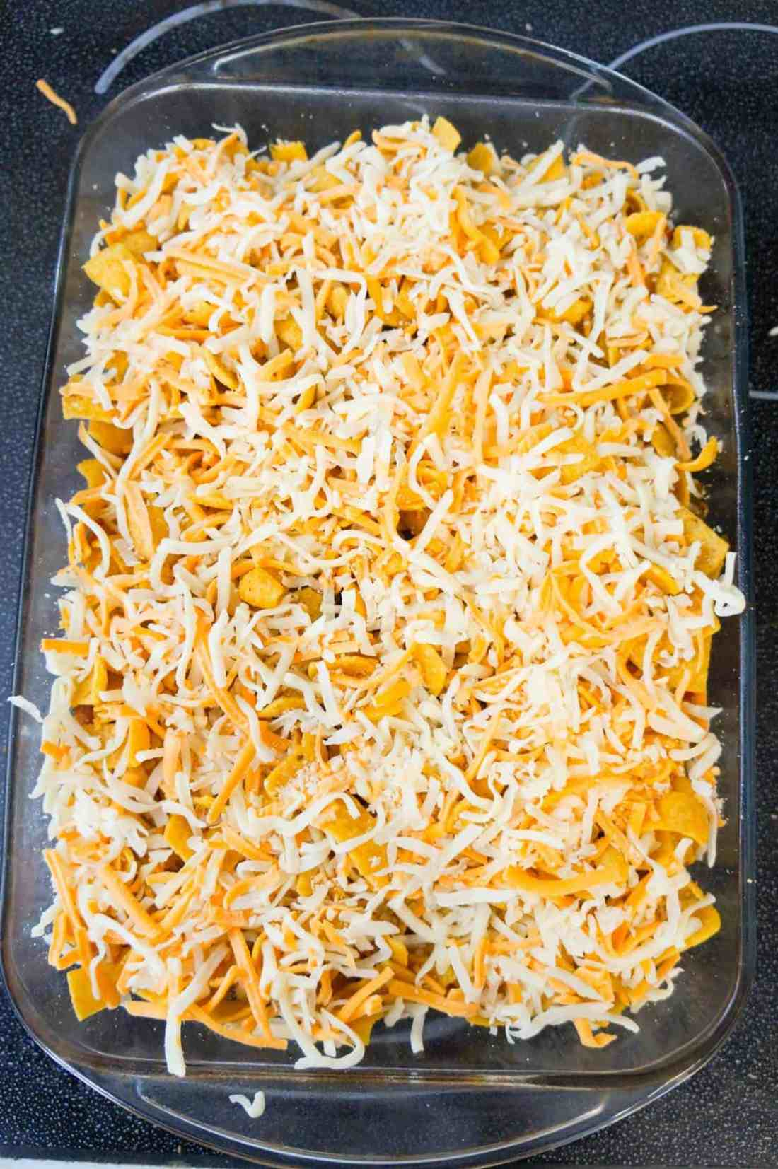 shredded mozzarella and cheddar cheese on top of frito pie