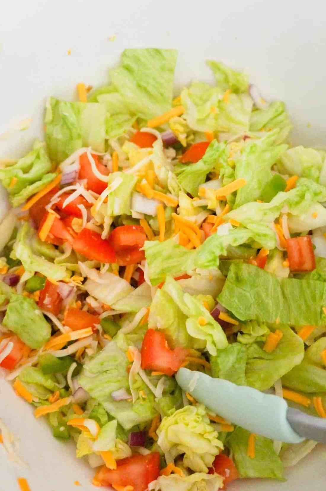 tossed salad in a mixing bowl