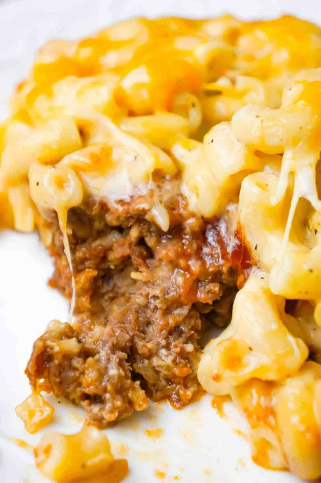 Mac and Cheese Meatloaf Casserole is a hearty dinner recipe with a ground beef meatloaf base with macaroni and cheese baked on top.