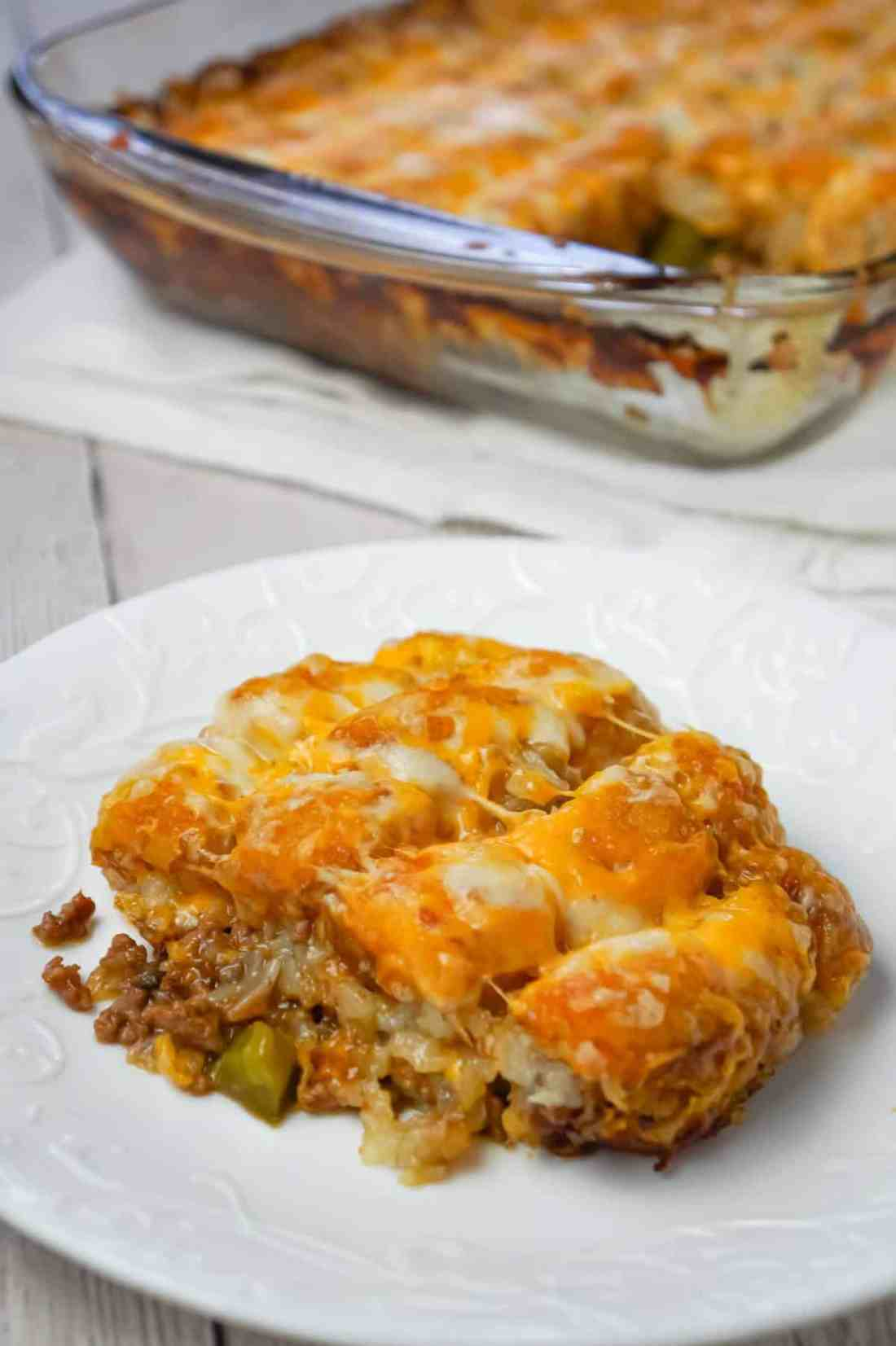 Philly Cheese Steak Tater Tot Casserole is a hearty dinner recipe with a base of ground beef, diced onion, diced green peppers and sliced mushrooms tossed in brown gravy and topped with shredded cheese and tater tots.