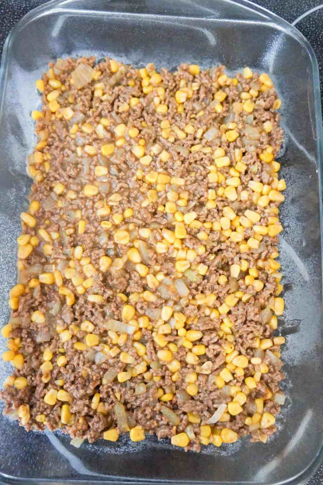 ground beef and corn mixture in a baking dish
