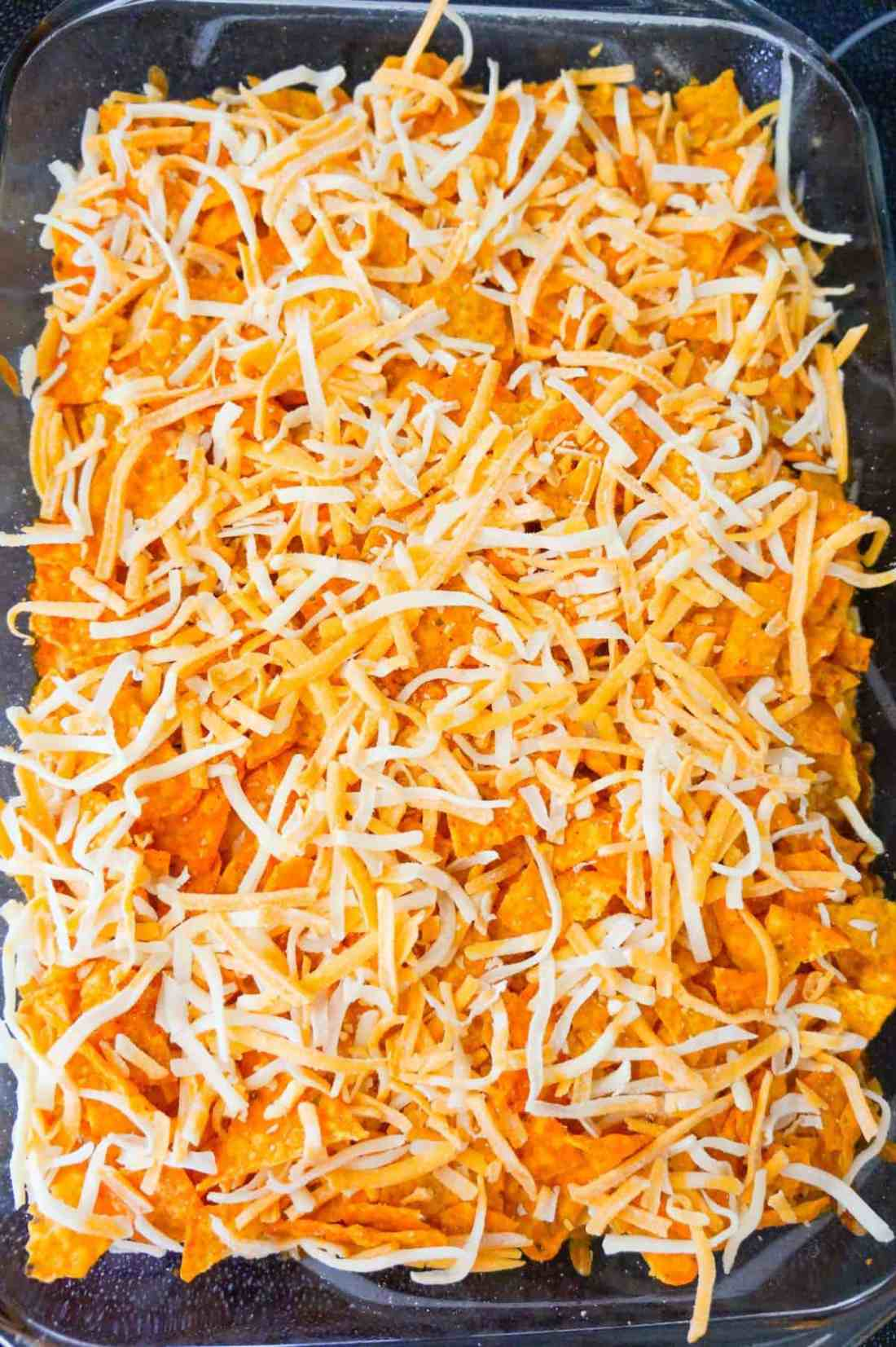 shredded cheese on top of Doritos chili pie