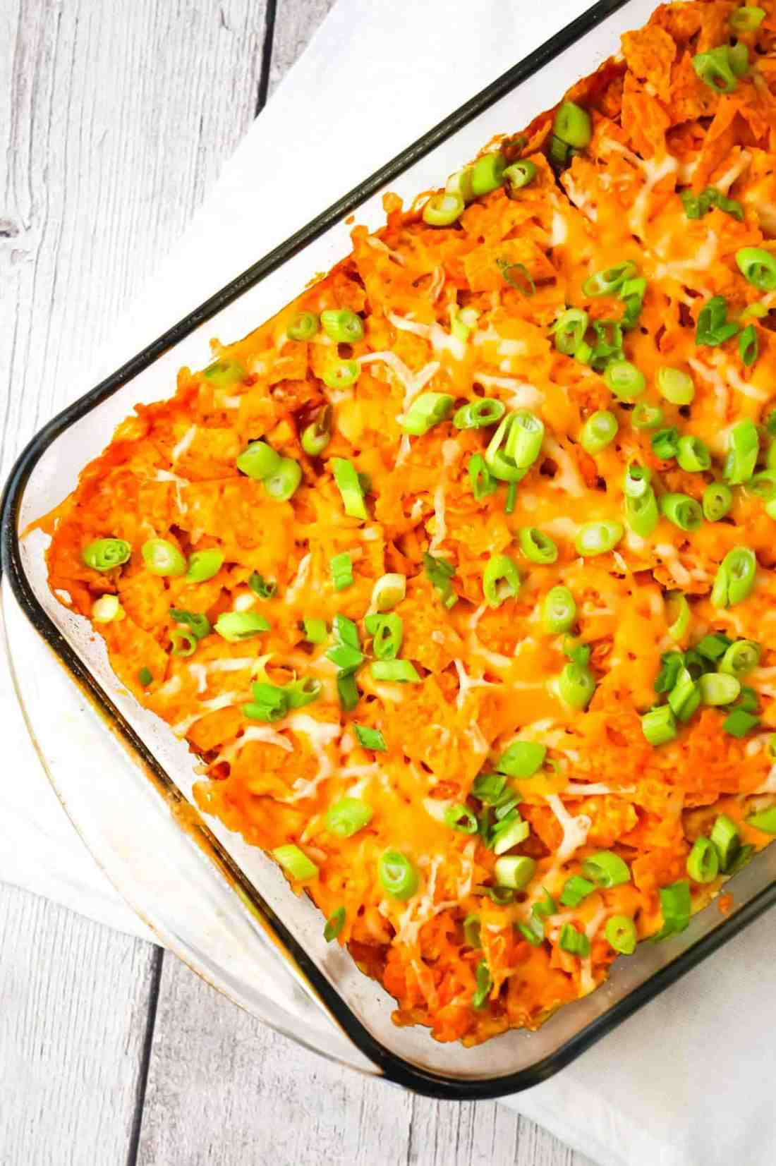 Doritos Chili Pie is an easy ground beef casserole recipe loaded with chili sauce, chunky salsa, corn, shredded cheese, crumbled Doritos and chopped green onions.
