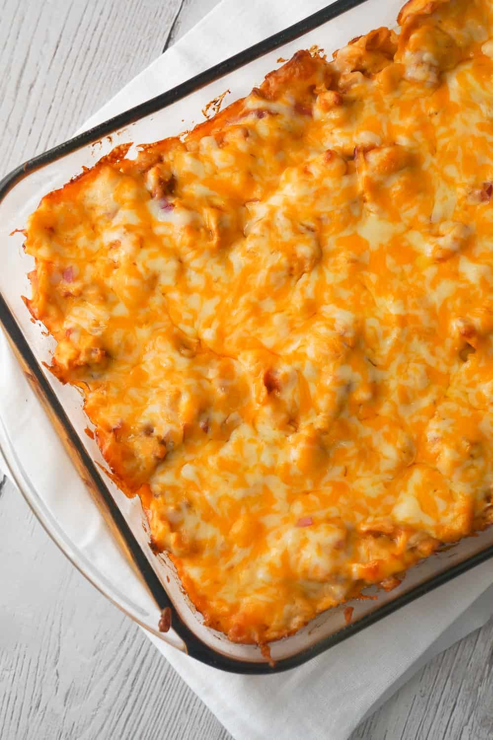 BBQ Chicken Tortellini Casserole is an easy dinner recipe using rotisserie chicken. This baked tortellini is loaded with bacon, chicken, red onions, BBQ sauce and cheddar cheese.