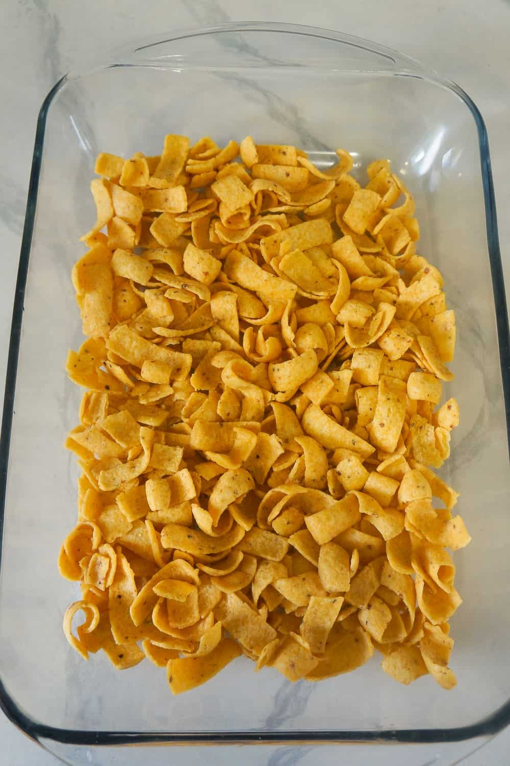 corn chips in the bottom of a baking dish