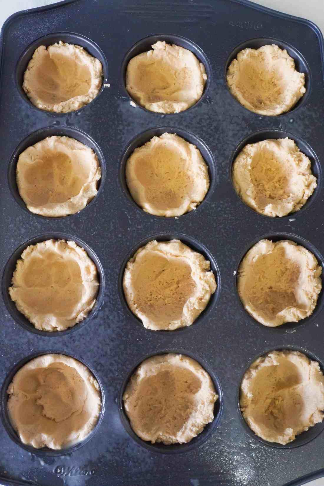 peanut butter cookie dough in muffin tin