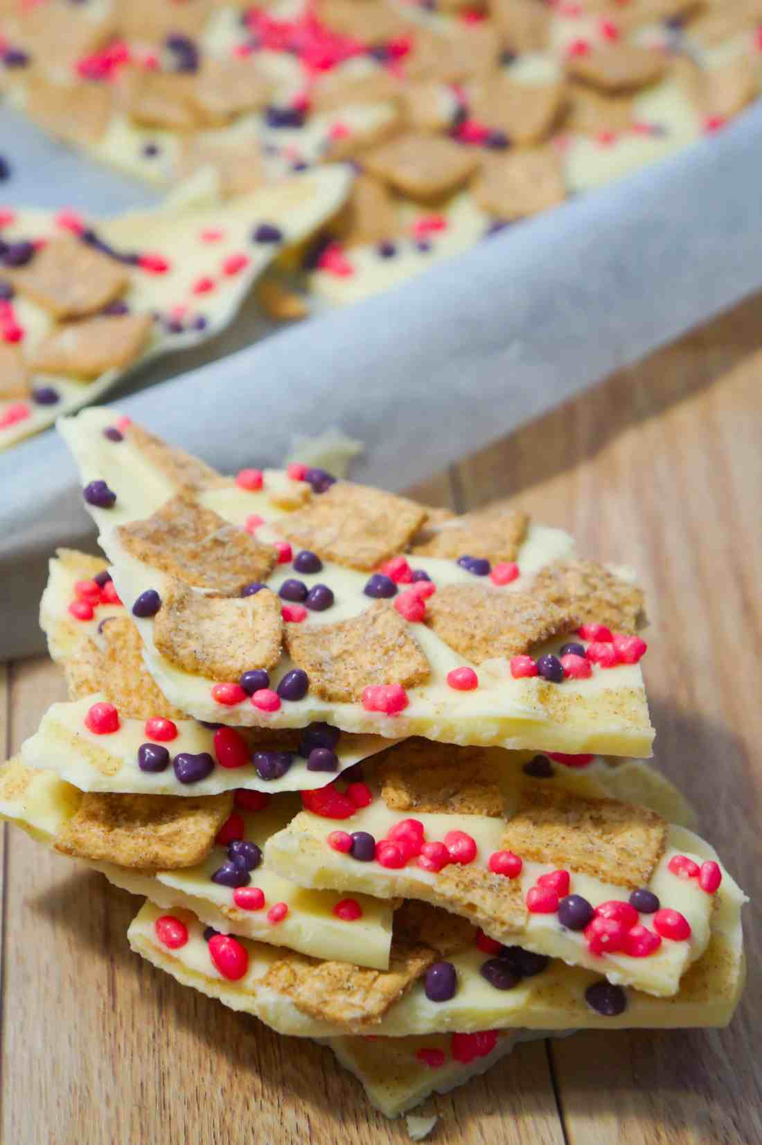 Cinnamon Toast Crunch White Chocolate Bark is an easy no bake dessert recipe. This white chocolate dessert is loaded with Cinnamon Toast Crunch Cereal and pink and purple Nerds candies.