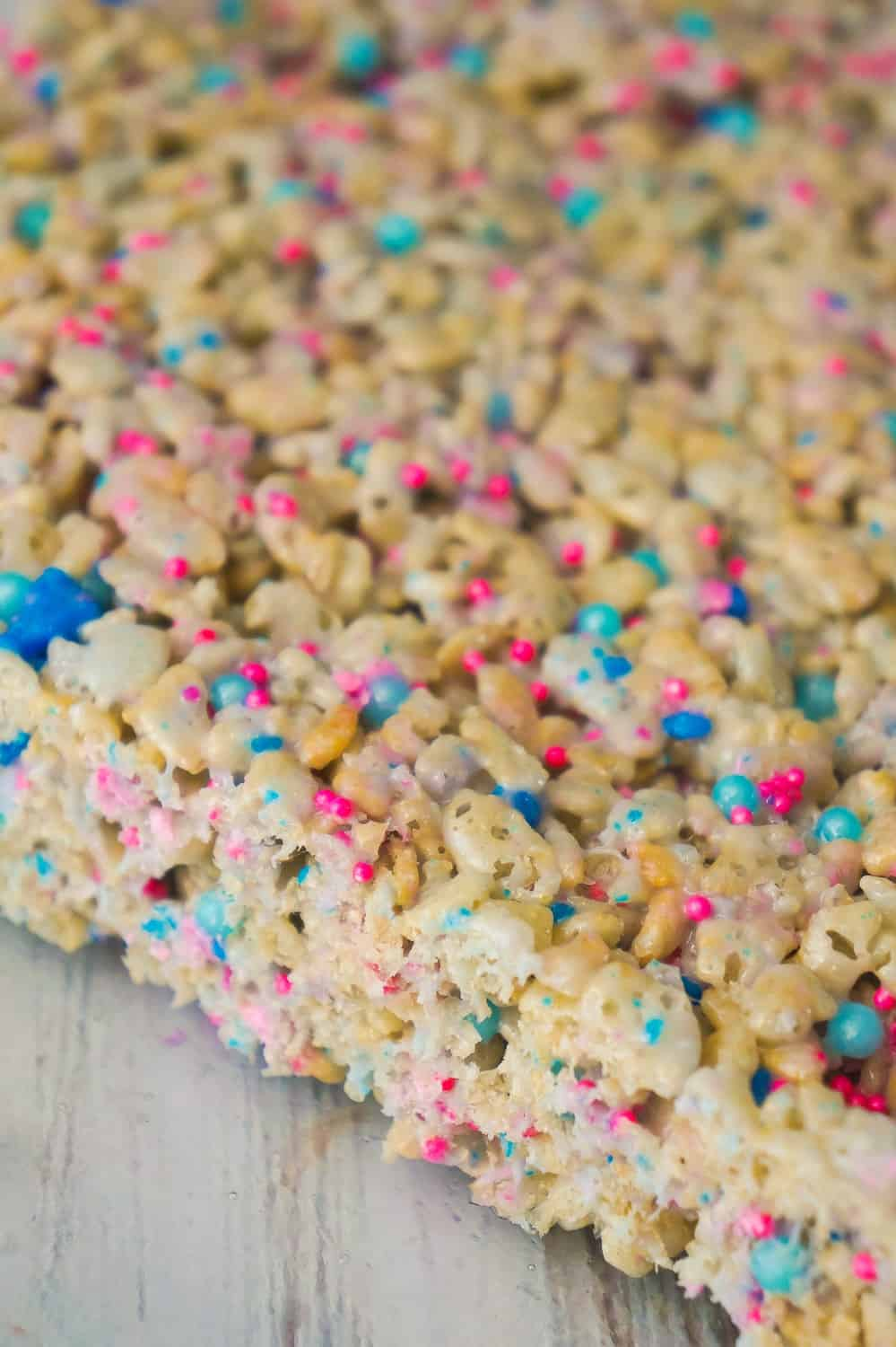 Cotton Candy Rice Krispie Treats are an easy dessert recipe your kids will love. These rice krispie squares are made with melted cotton candy and loaded with cotton candy coloured sprinkles.