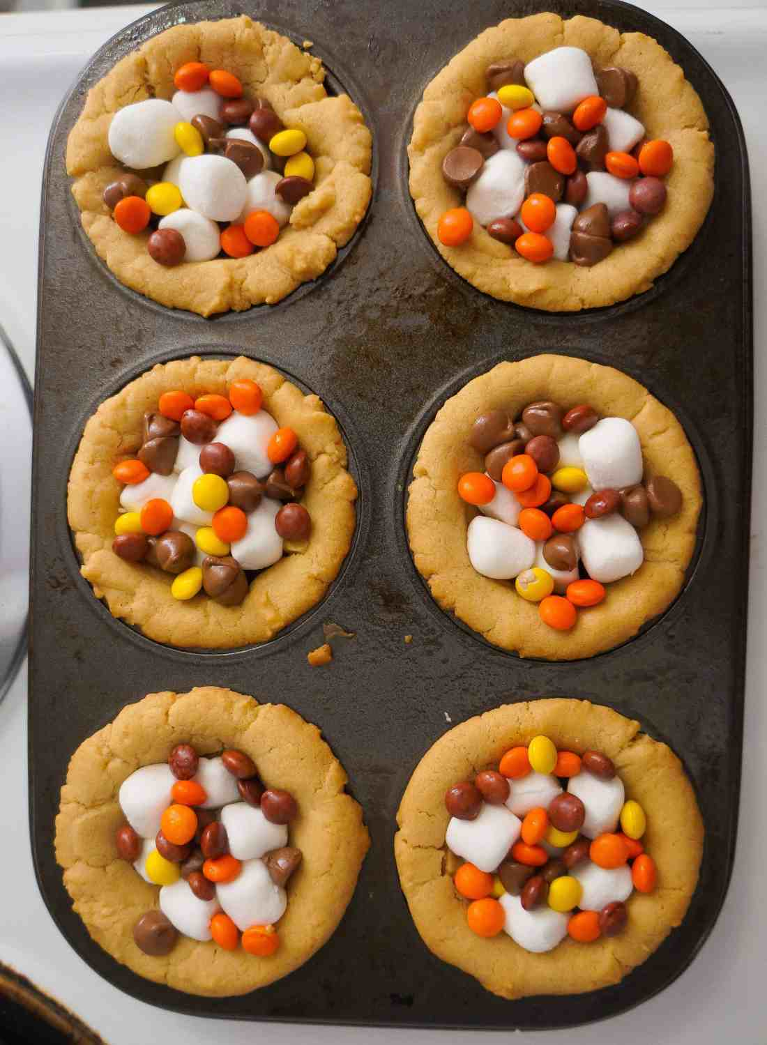 peanut butter cookie cups with mini Reese's pieces