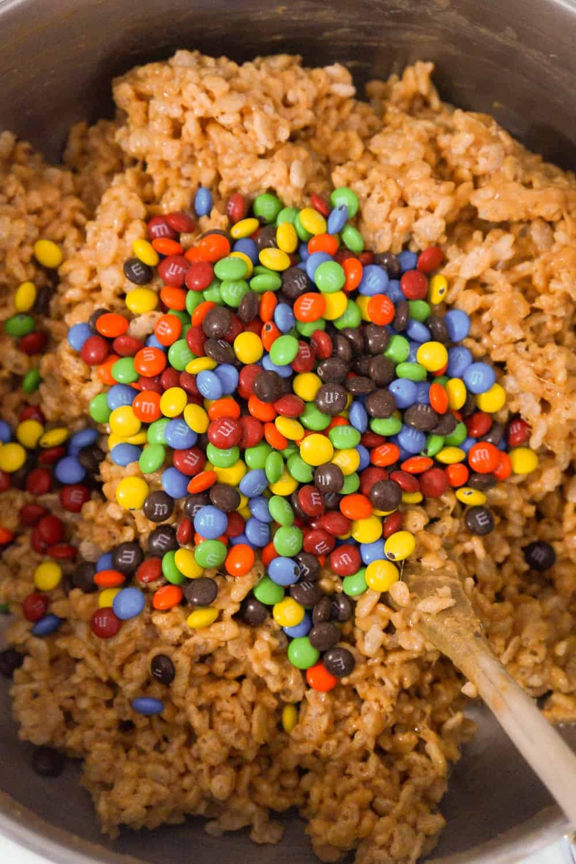 mini m&ms added to rice krispie mixture