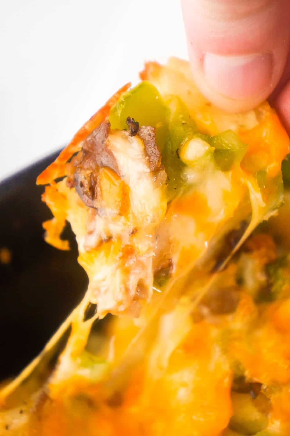 Philly Cheese Steak Pull Apart Bread is an easy party food perfect for game day. Bite sized pieces of bagel are loaded with roast beef, green peppers and cheddar cheese.