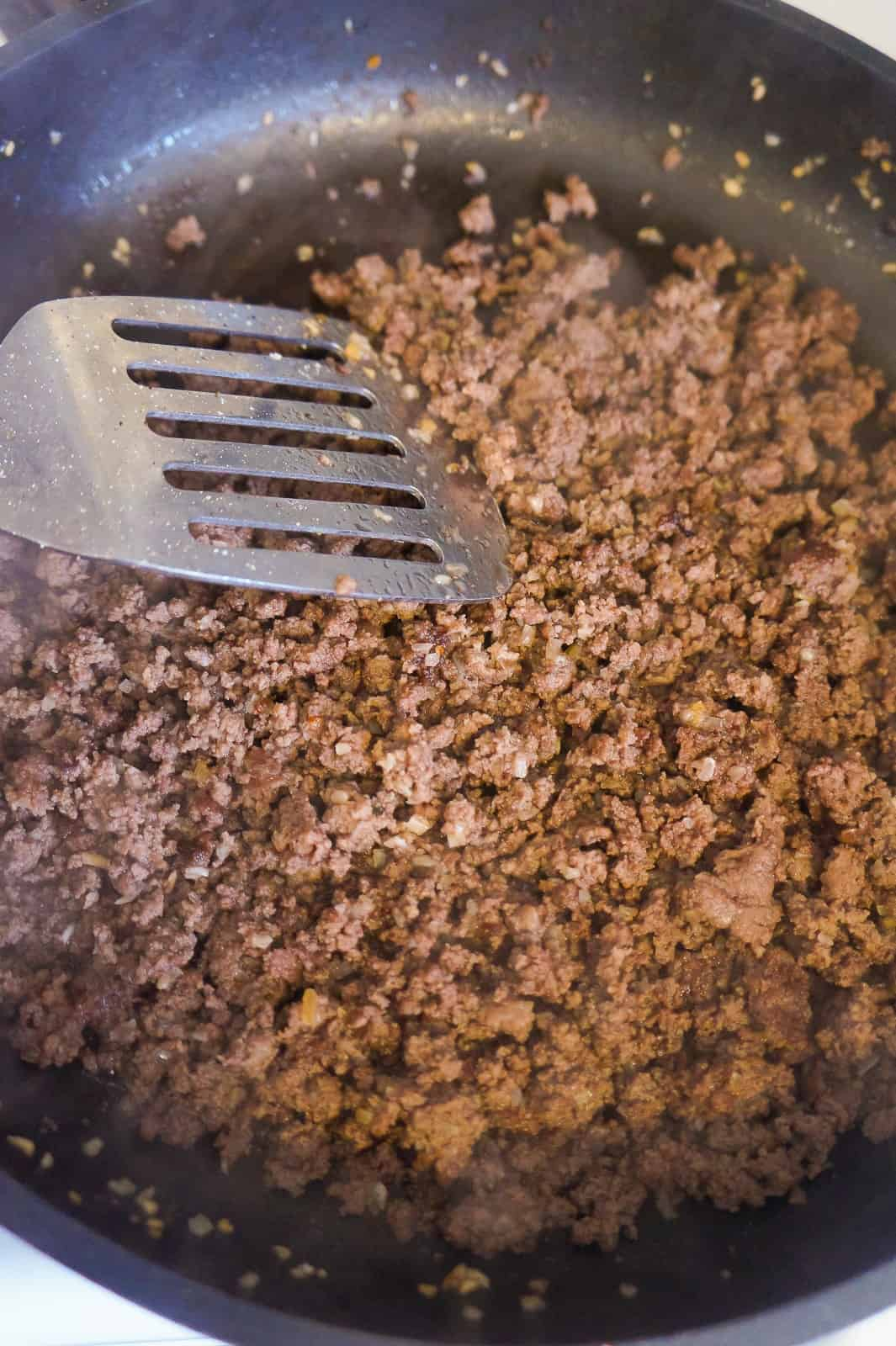 cooked ground beef in frying pan