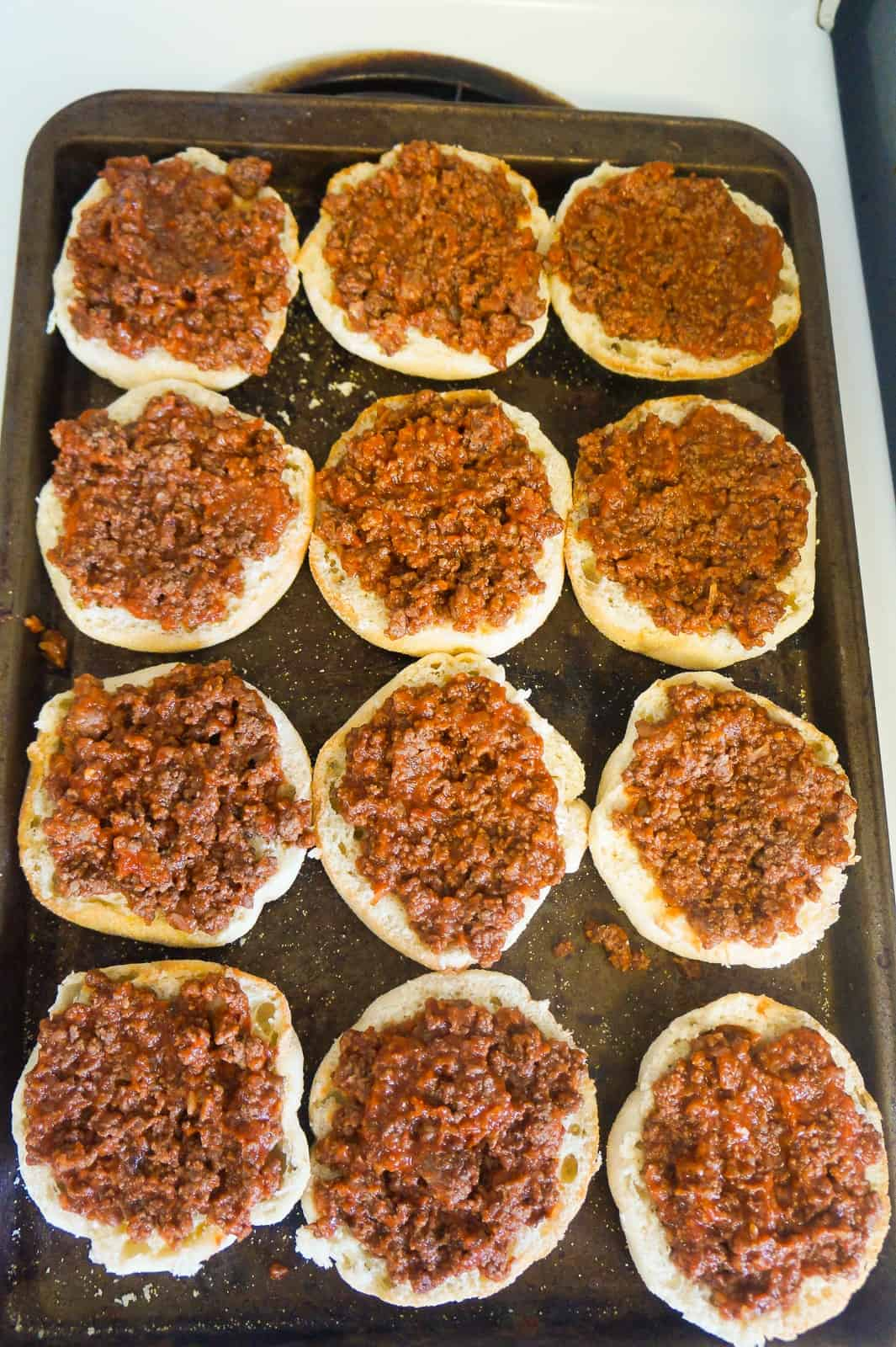 ground beef and pizza sauce on english muffins