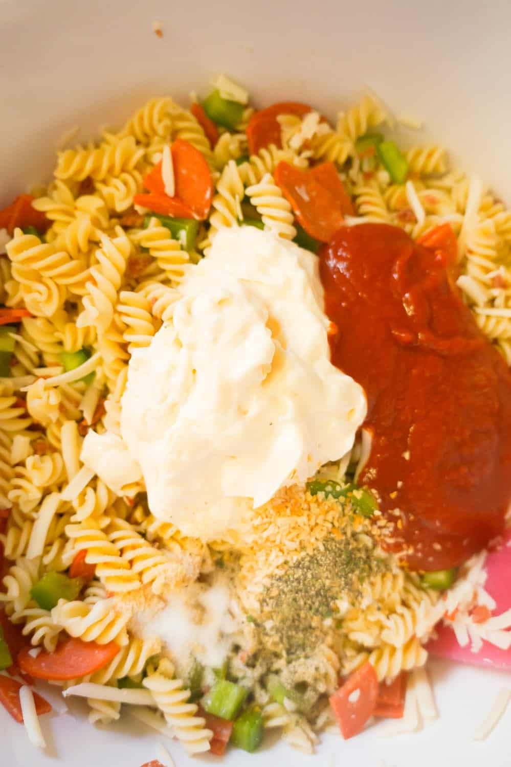 pizza pasta salad with mayo and pizza sauce on top