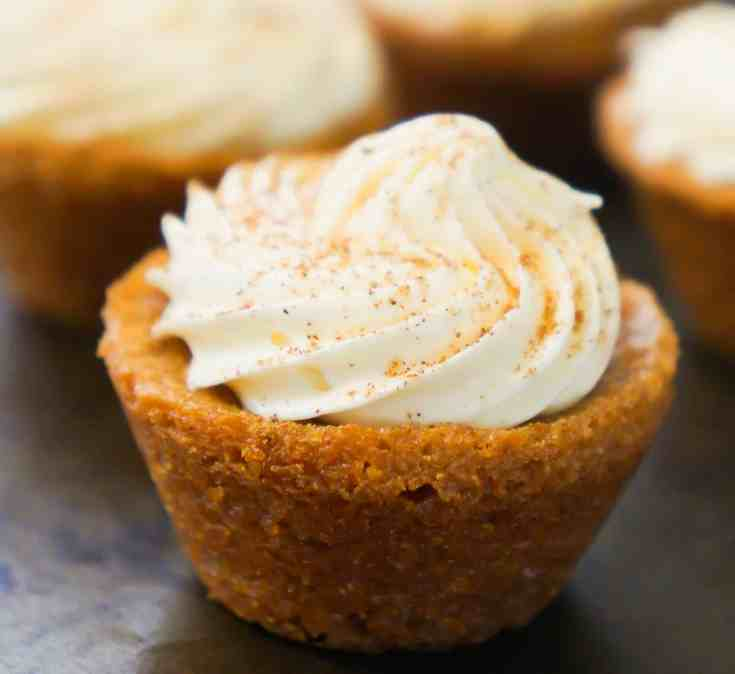 Bite size pumpkin spice blondies with cream cheese frosting. Perfect dessert for Thanksgiving and Halloween.