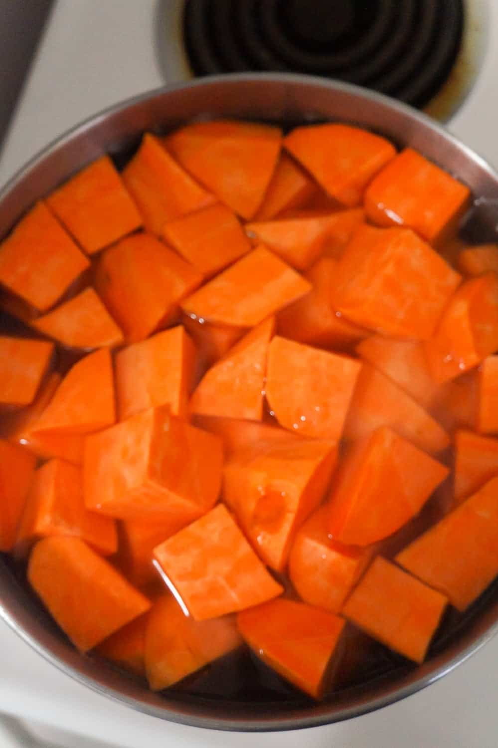sweet potato chunks in a pot of water