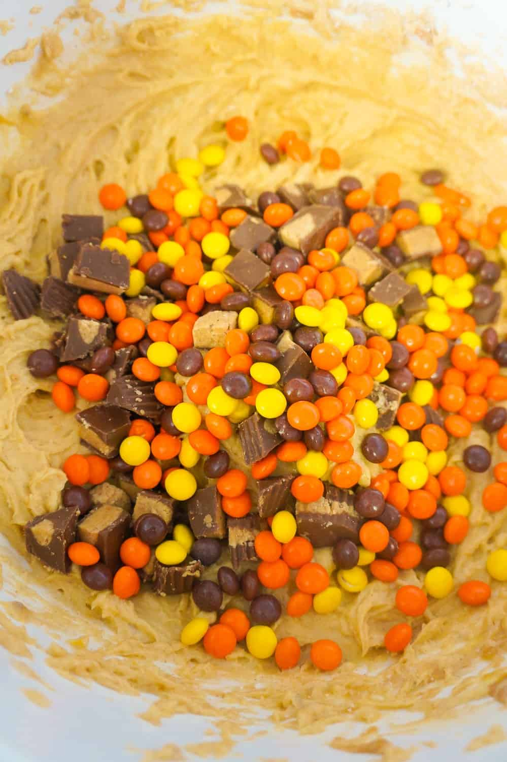 mini Reese's Pieces in peanut butter banana cake batter