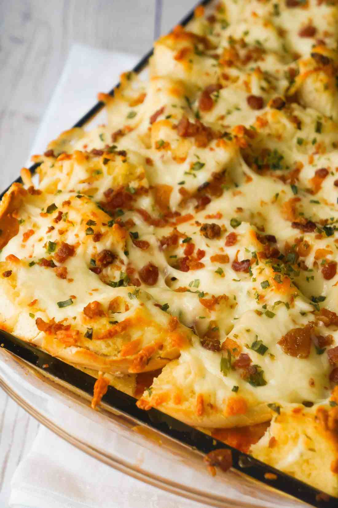 baked spaghetti and meatball casserole topped with garlic cheese bread
