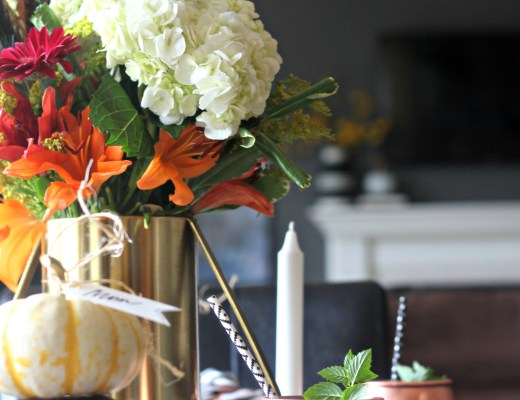 Adding a feather to your floral centerpiece instantly updates it for fall! | How to create a warm and welcoming fall tablescape | This is our Bliss | www.thisisourbliss.com