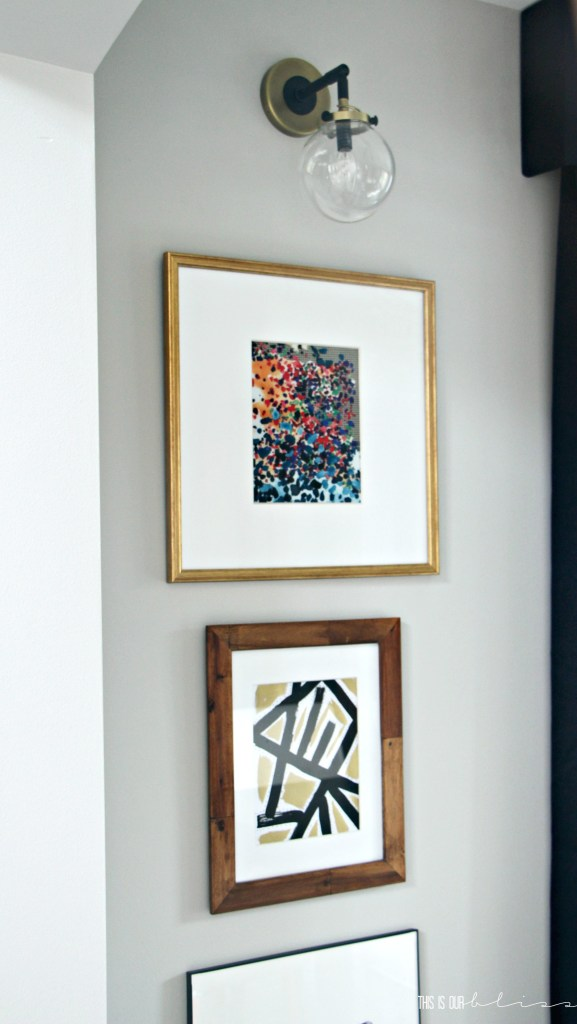 stacked-frames-under-sconces-dining-room-art-display This is our Bliss