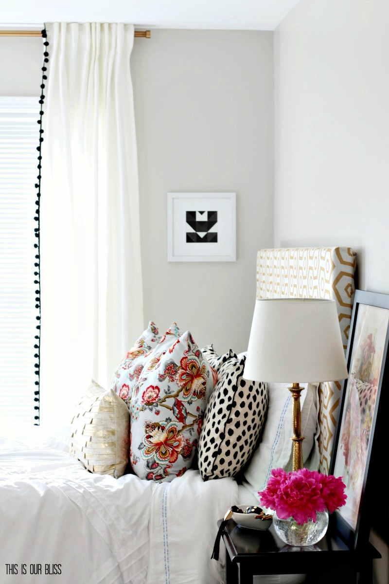 Bright and cheery guestroom with color, pattern and fresh flowers