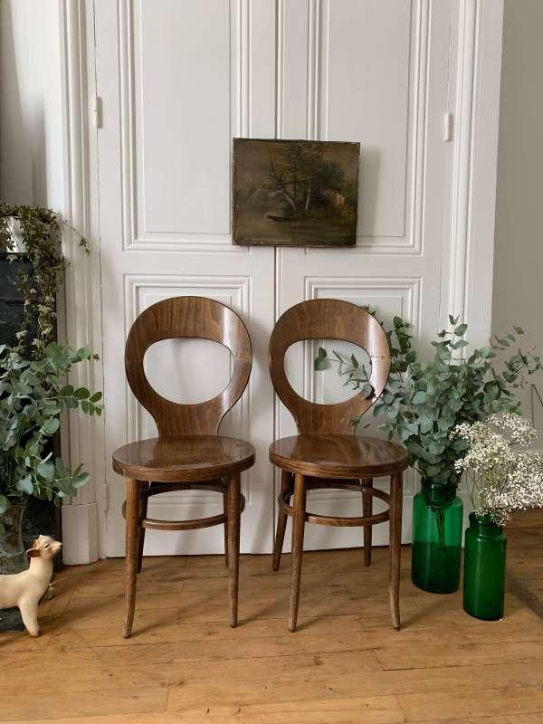 """Paire de chaises de bistrot modèle """"mouette"""" de Baumann."""