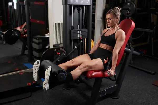 Woman performing Leg Extension exercise
