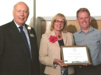 Andy Richards and Jenny Mitchelmore, accepting the Award from Lord Julian Fellowes